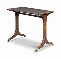 A REGENCY BRASS-MOUNTED ROSEWOOD WRITING TABLE CIRCA 1810, IN THE MANNER OF GILLOWS With tooled leather top and high stretcher 28 ½ in. (72.5 cm.) high; 36 in. (92 cm.) wide; 21 ¼ in. (54 cm.) deep