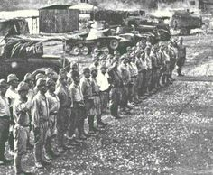 An element of the Imperial Japanese Army 1st Tank Regiment stands at attention upon insertion into Malaya, 1942