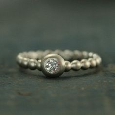 I LOVE this ring! Its whimsical yet stylish and is great as a centerpiece in your stacking set or worn alone.  Hand created from our 2.5mm wide 14K white gold beaded band from our other shop; https://www.etsy.com/listing/220224084  A white gold bezel is added and masterfully set with a genuine .10ct 3mm conflict free white diamond. It is S12 quality and G-H color. Your ring will be custom made to size just for you and can be given either a brushed or high polished finish. ...