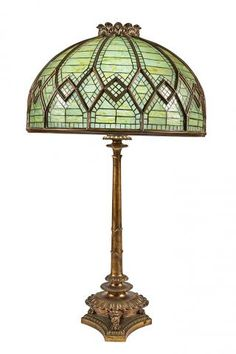 Tiffany Studios Gilt-Bronze and Leaded Favrile Glass Oversize Table Lamp Commissioned for Henry J. Hardenbergh's Hotel Manhattan, circa 1897 Shade stamped TIFFANY STUDIOS NEW YORK, base apparently unmarked. Height overall 53 3/4 inches, height of shade 18 3/4 inches, diameter 31 inches.