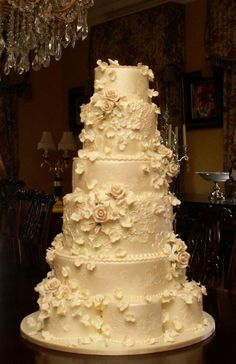 Just beautiful! elegant wedding cake. Except the flowers in color of the bridesmaids dresses