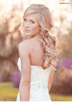 Another romantic hairstyle - perfect for the bride going for a soft, elegant yet subtly sexy look!