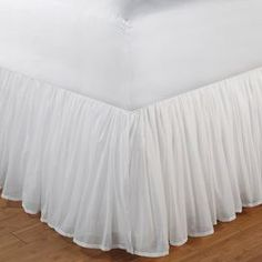 "Cotton blend bedskirt.   Product: BedskirtConstruction Material: Cotton and polyesterColor: WhiteFeatures: 15"" Drop  Sheer cotton voile drop with a separate lining in a matching color for opaque coverageSoftly gathered for a tailored look Cleaning and Care: Machine washable"