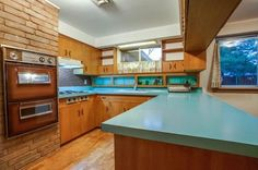 Screenshot I just took of a house up for sale in Texas. Love, love, love a time-capsule kitchen. <3