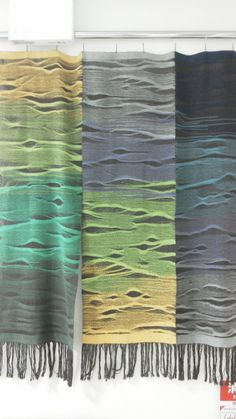 Amazing use of weft thread gives the impression of a hilly landscape in the mist.