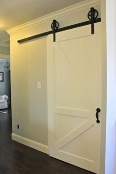 sliding door for separating finished and unfinished basement parts
