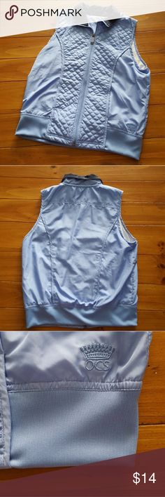 Oleg Cassini Sport women's zipper vest Oleg Cassini Sport women's lightweight blue zipper vest with pockets in front.  Shell  and filling 100% polyester, lining 100% cotton.  Machine wash.  In like new condition Oleg Cassini Sport Jackets & Coats Vests