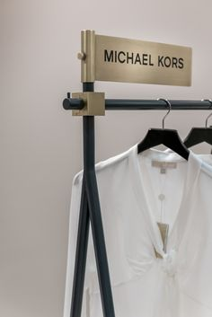 simple but striking stand alone rails for clothes can easily be moved, don't look cluttered.