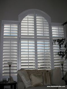 For your Living Room capture the elegant shape of your window with custom arched shutters