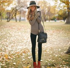 tan top black jeans and red ankle boots!