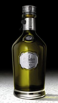 Rare old bottle of 50-year-old Glennfidich on way to Bar 1919 in the Blue Star Arts Complex. Read more at: www.SavorSA.com/2013/08/rare-bottle-of-glenfiddich-50-year-old-is-on-its-way-to-san-antonio