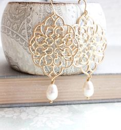 Bridesmaid Earrings - think brilliant blue stone or crystal.