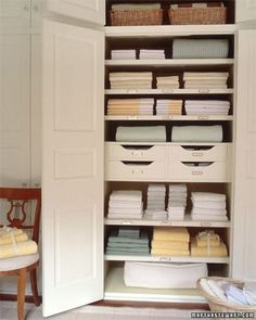 Organizing a Linen Closet - Martha Stewart Home & Garden: 10 inches for sheets; 18 inches for blankets at the top of the cupboard Boys Closet, Hall Closet, Closet Space, Martha Stewart Home, Linen Cupboard, Airing Cupboard, Linen Closet Organization, Closet Storage, Diy Organization