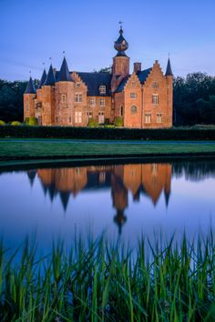 "Photographed the ""Kasteel van Rumbeke"" ( Castle of Rumbeke ) close to Roeselare (Belgium) at dusk. Used a lightweight MyFoto tripod with the Fuji X-E1 + 18-55 lens attached.Image is a 3 shot (-2, 0, +2EV) blended as a 32 bit image in Lightroom"