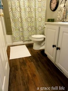 Stick and peel vinyl plank flooring. Available at Lowes. Sticks to existing flooring. Informations About Master Bathroom Makeover- There is NUTHIN' Master About This Bath Pin You can easily use my pro Vinyl Wood Planks, Wood Plank Flooring, Wood Vinyl, Vinyl Flooring, Flooring Ideas, Linoleum Flooring, Basement Flooring, Bathroom Renos, Bathroom Flooring