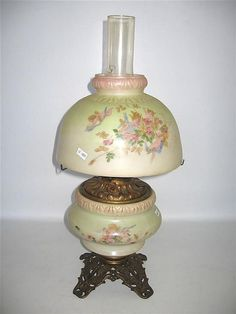 A 19th century American ?Gone with the Wind? banquet lamp,brass and opal glass pastel green and pink with cherubs
