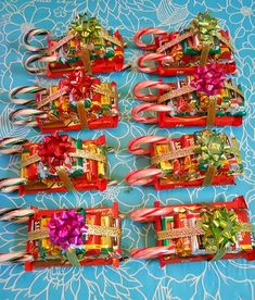 Candy Sleighs: Hot glue gun, 1 standard KitKat bar, 2 candy canes, 10 mini Hershey bars (stacked 4, 3, 2, 1), ribbon & a bow on top!
