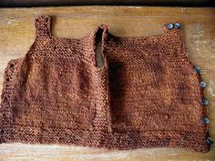 Henry's Pebble Vest, unbuttoned by QueenieVonSugarpants, via Flickr Free Ravelry