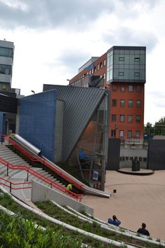 A public slide for commuters has been constructed at a train station in Utrecht, the Netherlands. To access the station platform of. Stair Slide, Utrecht, Article Design, Slide Design, Pantone, Holland, Stairs, Vacation, Mansions