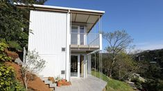 Perched on the side of a cliff, the house offers views across the valley and also out to sea. Cliff Edge, Compact House, Grand Designs, Kit Homes, Architect Design, Go Green, Fencing, Home Decor Inspiration