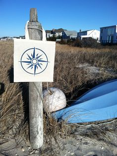 Compass rose on the wind sock pole.  In the summer we use that kayak to tow that white float out about 50 yards and anchor it.