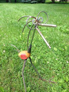 Golf and nut cracker bird Recycled garden sculpture by nbillmeyer