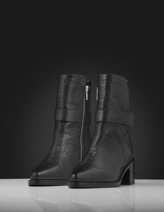 Raysse boots Women's black ankle boot in grainycalf leather with calf lining. Features a wraparound ankle strap and pointy toe. Full leather outsole with half rubber outsole on top. Leather Interior, Black Ankle Boots, Wraparound, Women's Shoes, Ankle Strap, Calves, Wedges, Toe, Heels