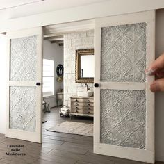 The #WillowbridgeHouse bathroom needed some privacy so I made some big old pressed tin sliding doors🚪 Swipe to see how I made them from…