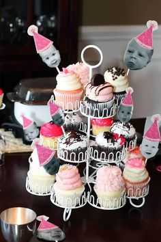 cupcakes with toppers made from lollipop sticks, b/w pictures of the birthday girl, and party hats i printed off my computer from google images. all held together by a glue gun.