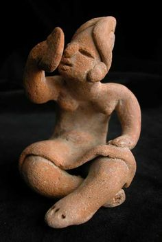 Sculpture of a Seated Woman Looking at a Mirror. Origin: Xochipala, Mexico - Circa: 1200 BC to 900 BC