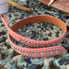 """Triple D Pink Rhinestone Leather Western Belt This belt is pink with studs and rhinestones. It will be perfect for the rodeo or spring season ahead for that western boho touch. Studs run the length both top and bottom and large rhinestones align in the center.  This belt is a size 26.  30"""" long and will fit 24"""" to 26"""" waist. 1"""" wide.  Pair this blingy belt with your favorite buckle and you're ready to go. Triple D Accessories Belts"""