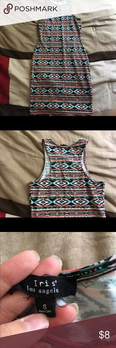 Aztec print sleeveless fitted dress This dress 31 inches in length from the shoulder. It is very fitted, with very stretchy fabric. It's perfect on a hot summer day. The fabric is very lightweight and breathable. You could wear this over your bathing suite at the beach. The colors are very vibrant and stand out. Reasonable offers are always welcome. Or    💞BUNDLE AND SAVE💞 Bundle offers are ALWAYS CONSIDERED. Dresses Midi