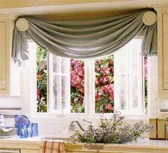 Rosette Holdbacks Into The Top Corners Of A Window Frame And Drape Hemmed Length Fabric Over Them