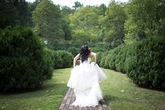 Runaway bride - beautiful. From a DIY pruple & orange, rustic Northern Virginia wedding. Images by Kristi Odom Photography.