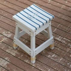 Give a plain stool a nautical finish with gray-wash paint and stripes!