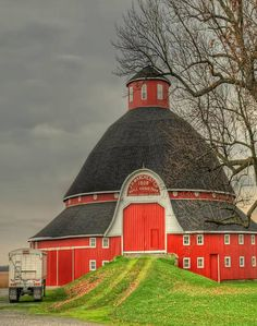 beautiful red barn with dome and turret top