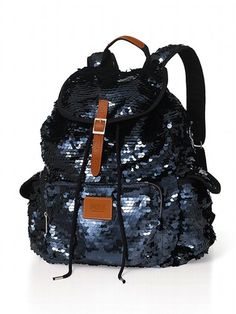 black sequined backpack with leather details.