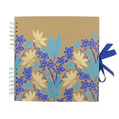 Scrapbook with pretty garden butterfly pattern in blue and cream on a brown Kraft cover from Paperchase. #stationery #scrapbook
