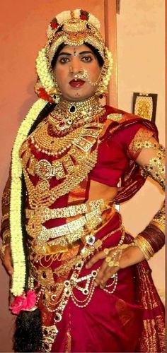 Indian bride with Big Jumka's and Heavy jewelry.