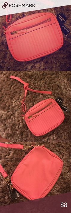 Fun Pink/Salmon Colored Purse Bought this purse for my daughter, and then she outgrew pink.  Apparently.  It's a pinkish PG salmon color, with gold trim on handle and zippers.  Front zipper closure along with zipper pocket inside. George Bags Shoulder Bags