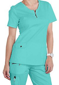 """These must-have tees are exclusive to Scrubs & Beyond!  The Beyond Scrubs long sleeve tees are perfect for layering, adding a pop of color, or wearing at home, the office, or after work!  The no-pill fabric will make these affordable tees an essential part of your wardrobe! <ul> <li>Long sleeves<br> <li>Round neck<br> <li>27"""": length<br> <li>55 percent cotton/40 percent polyester/5 percent spandex</br> </ul>"""