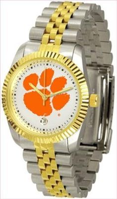 Clemson Tigers Suntime Mens Executive Watch - NCAA College Athletics by SunTime. $133.95. Links Make Watch Adjustable. Men. Stainless Steel. 23kt Gold-Plated Bezel. Officially Licensed Clemson Tigers Men's Two Tone Gold Dress Watch. For a more formal look. The Executive features a fluted gold toned bezel and two tone gold overlay and stainless steel link bracelet. Now with Date Calendar feature. Wear it to a game, while watching a game or just to show off your NCAA...