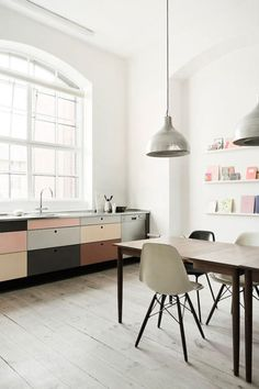 This minimalist dining room and kitchen work well in this industrial loft space.