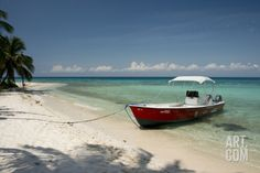 Belize, Stann Creek. Laughing Bird Caye Red Boat on Beach Photographic Print by Cindy Miller Hopkins at Art.com