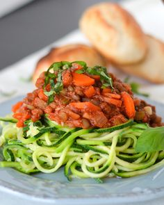 "Spiralized zucchini noodles are topped with a vegan bolognese sauce ""beefed"" up with lentils and finely chopped mushrooms. It's so yummy, you won't even miss the meat!"