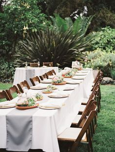 garden reception tables with a grey table runner, photo by Allie Lindsey Photography http://ruffledblog.com/san-diego-botanic-garden-wedding #weddingreception #weddingideas