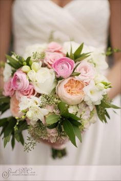 Bridal Bouquet made by Fleur De Lis & Styled Bride. Color palette of coral, peach, ivory and green.