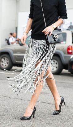 A fringe skirt and classic black heels