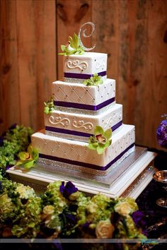 Our beautiful purple and green wedding cake with cymbidium orchids by Cinda's Creative Cakes & Expressions of Love florist!