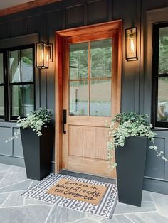 Tis the season of summer days and outdoor spaces to enjoy them, so check out our fab collection of farmhouse style ideas for your porch. door decorate apartment 12 Gorgeous And Inviting Farmhouse Style Porch Decorating Ideas 11 Front Door Design, Front Door Decor, Wood Front Doors, Front Porch Fall Decor, Front Porch Plants, Front Door Lighting, Exterior Lighting, Planters By Front Door, Home Front Door